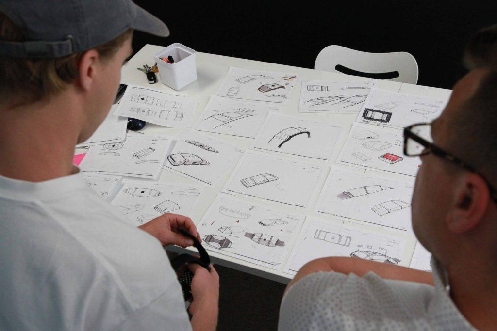 Cortex designers looking over concept sketches