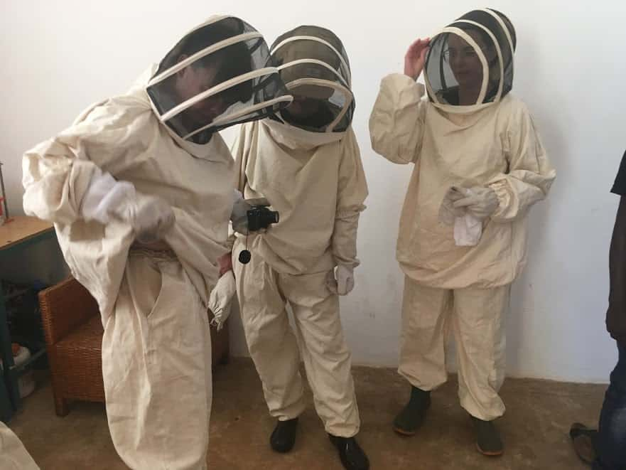 Design abroad students try on beekeeping suits